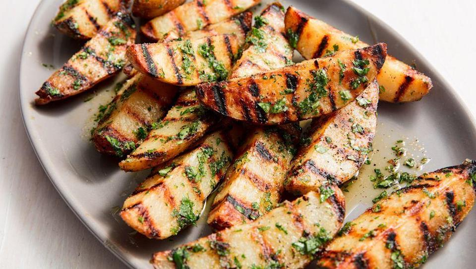 """<p>These grilled potato wedges are perfect with a bit of garlic powder, drizzle of olive oil and a sprinkle of parsley.</p><p>Get the recipe from <a href=""""https://www.delish.com/cooking/recipe-ideas/a20164811/best-grilled-potatoes-recipe/"""" rel=""""nofollow noopener"""" target=""""_blank"""" data-ylk=""""slk:Delish"""" class=""""link rapid-noclick-resp"""">Delish</a>.</p>"""
