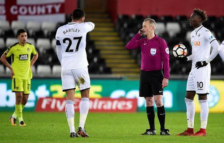 Soccer Football - FA Cup Fourth Round Replay - Swansea City vs Notts County - Liberty Stadium, Swansea, Britain - February 6, 2018 Referee Martin Atkinson consults the VAR (video assistant referee) before awarding the first goal for Notts County scored by Noor Husin REUTERS/Rebecca Naden