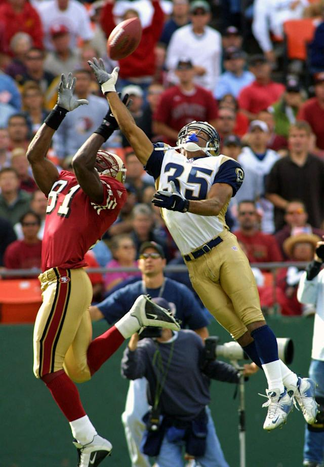 FILE - In this Sept. 23, 2001 file photo, St. Louis Rams cornerback Aeneas Williams, right, breaks up a pass in the end zone intended for San Francisco 49ers Terrell Owens in the fourth quarter of an NFL football game in San Francisco. Williams elected to the Pro Football Hall of Fame on Saturday, Feb. 1, 2014. (AP Photo/John Todd, File)
