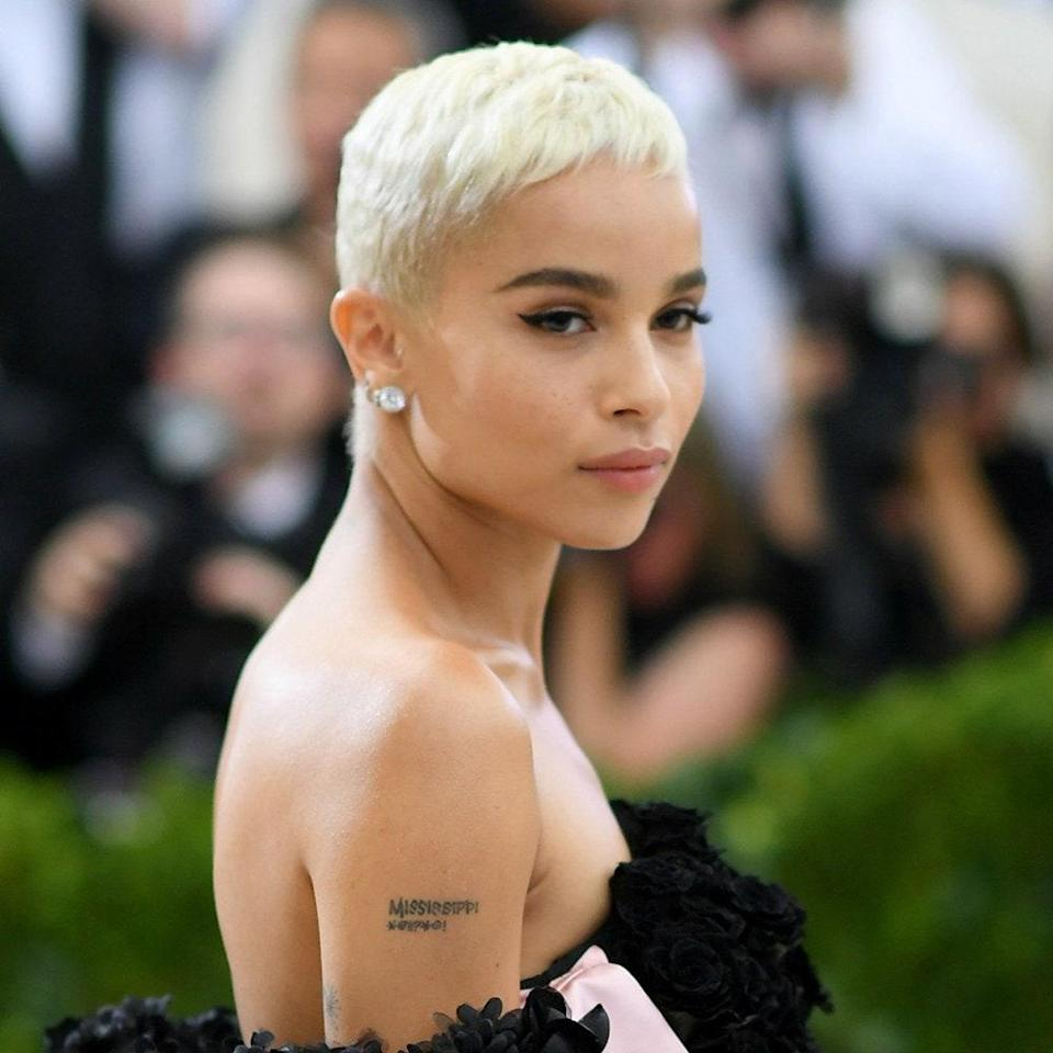 """Even a few years after its debut, Zoë Kravitz's <a href=""""https://www.glamour.com/gallery/platinum-blonde-hair-ideas?mbid=synd_yahoo_rss"""" rel=""""nofollow noopener"""" target=""""_blank"""" data-ylk=""""slk:platinum pixie"""" class=""""link rapid-noclick-resp"""">platinum pixie</a> is still inspiring, and its popularity doesn't seem to be slowing down. """"It's so cutting-edge but still so chic,"""" says <a href=""""https://www.ninezeroonesalon.com/"""" rel=""""nofollow noopener"""" target=""""_blank"""" data-ylk=""""slk:Nine Zero One Salon"""" class=""""link rapid-noclick-resp"""">Nine Zero One Salon</a> stylist <a href=""""https://www.instagram.com/anthonyholguin/"""" rel=""""nofollow noopener"""" target=""""_blank"""" data-ylk=""""slk:Anthony Holguin"""" class=""""link rapid-noclick-resp"""">Anthony Holguin</a>. """"When going platinum, be sure to go to someone who specializes in this, since it's difficult to achieve this look."""" He recommends asking for a pure-white platinum over an ashy-toned platinum, which can look too gray, and using <a href=""""https://shop-links.co/1719412582762903741"""" rel=""""nofollow noopener"""" target=""""_blank"""" data-ylk=""""slk:Olaplex Hair Perfector No. 3"""" class=""""link rapid-noclick-resp"""">Olaplex Hair Perfector No. 3</a> as well as a <a href=""""https://shop-links.co/1719412620110661046"""" rel=""""nofollow noopener"""" target=""""_blank"""" data-ylk=""""slk:color-correcting purple shampoo"""" class=""""link rapid-noclick-resp"""">color-correcting purple shampoo</a>—along with <a href=""""https://www.glamour.com/gallery/platinum-blonde-hair-products-reviews?mbid=synd_yahoo_rss"""" rel=""""nofollow noopener"""" target=""""_blank"""" data-ylk=""""slk:these hair-care picks"""" class=""""link rapid-noclick-resp"""">these hair-care picks</a> beloved by those with platinum hair."""