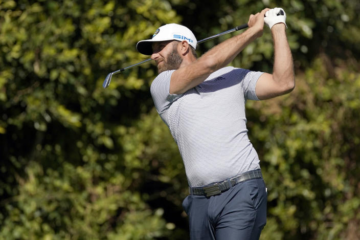 Dustin Johnson tees off on the fourth hole during the final round of the Genesis Invitational golf tournament at Riviera Country Club, Sunday, Feb. 21, 2021, in the Pacific Palisades area of Los Angeles. (AP Photo/Ryan Kang)