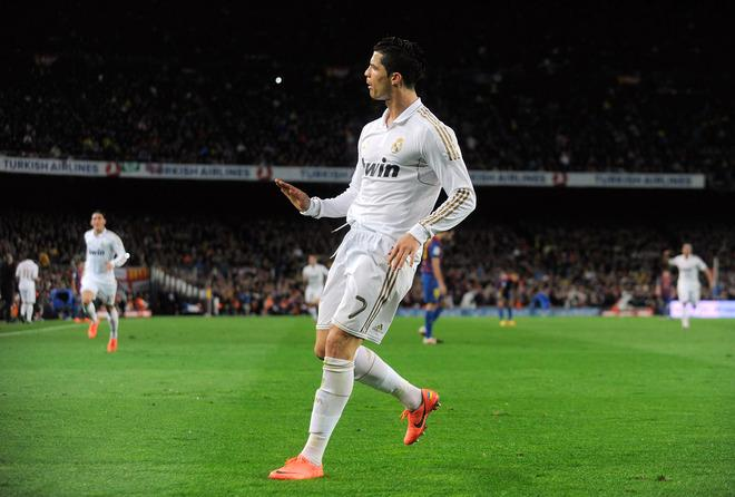BARCELONA, SPAIN - APRIL 21:  Cristiano Ronaldo of Real Madrid CF celebrates after scoring his team's 2nd goal during the La Liga match between FC Barcelona and Real Madrid CF at Camp Nou on April 21, 2012 in Barcelona, Spain.  (Photo by Denis Doyle/Getty Images)