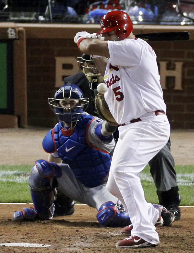 Texas Rangers' Scott Feldman hits St. Louis Cardinals' Albert Pujols during the fifth inning of Game 7 of baseball's World Series Friday, Oct. 28, 2011, in St. Louis. Texas Rangers' Mike Napoli catches. (AP Photo/Jeff Roberson)