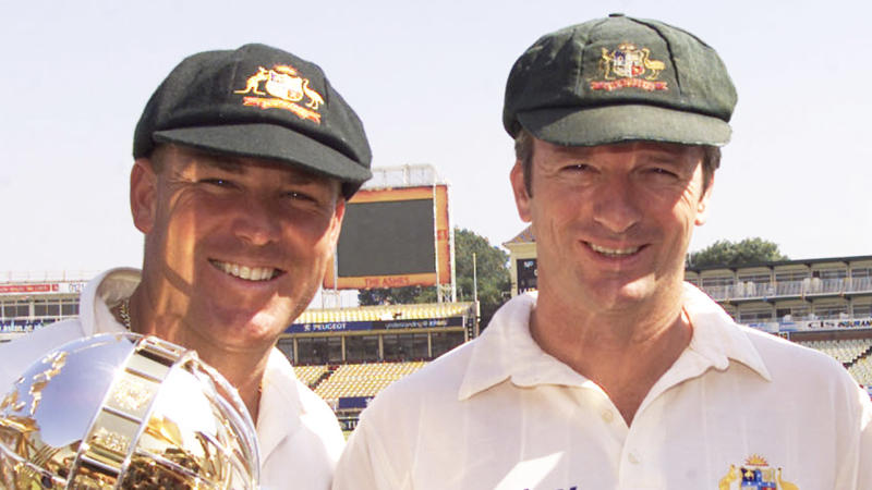 Shane Warne and Steve Waugh pose with a trophy for a photo.