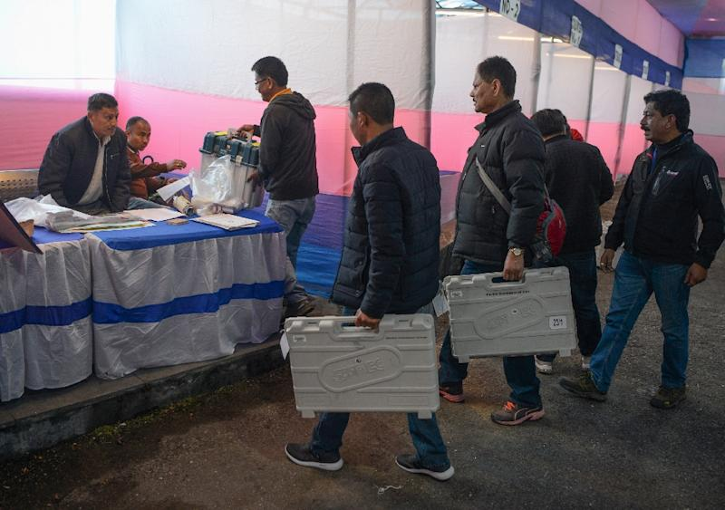 Indian election officials prepare a polling station in Darjeeling ahead of the next round of voting on April 16