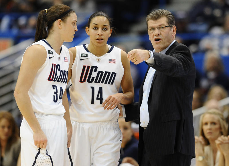 Connecticut head coach Geno Auriemma, right, talks with Connecticut's Kelly Faris and Bria Hartley in the first half of an NCAA college basketball game in the semifinals of the Big East Conference women's tournament in Hartford, Conn., Monday, March 11, 2013. (AP Photo/Jessica Hill)