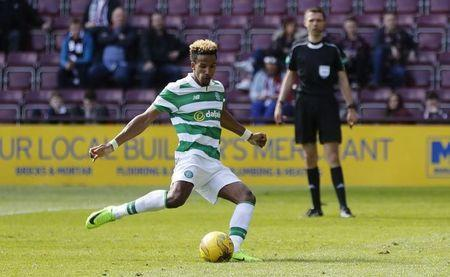 Britain Football Soccer - Heart of Midlothian v Celtic - Scottish Premiership - Tynecastle - 2/4/17 Celtic's Scott Sinclair scores their fifth goal with a penalty Reuters / Russell Cheyne Livepic