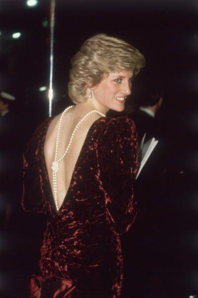 <p>As if attending the <em>Back to the Future </em>premiere as a royal isn't cool enough, Diana stunned in this plunging Catherine Walker gown. There's crushed velvet, there's exaggerated sleeves, and that long strand of knotted pearls—immaculate. </p>