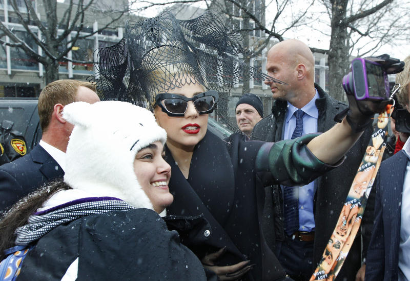 "Lady Gaga poses with fans prior to an event at Harvard University in Cambridge, Mass. Wednesday Feb. 29, 2012. Gaga launched her ""Born this Way"" foundation at Harvard. (AP Photo/Charles Krupa)"