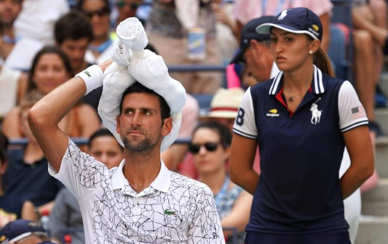 Survivor: Novak Djokovic cools off during his win over Joao Sousa in the fourth round of the US Open on Monday