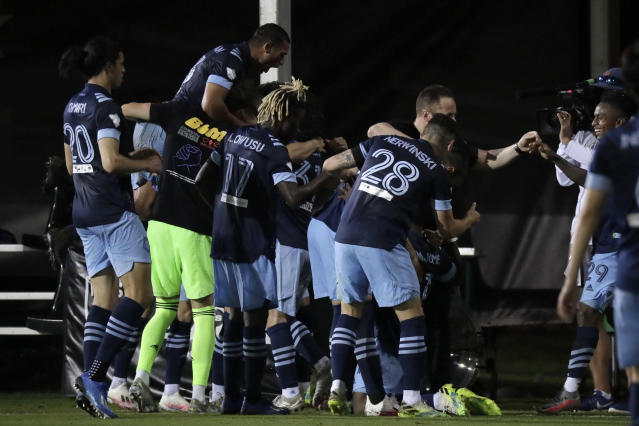 Vancouver Whitecaps players celebrate after forward Cristian Dajome scored a goal during the second half of an MLS soccer match against the San Jose Earthquakes, Wednesday, July 15, 2020, in Kissimmee, Fla. (AP Photo/John Raoux)