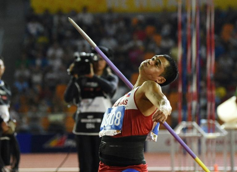 Home favourite Melvin Calano won the men's javelin at the SEA Games (AFP Photo/TED ALJIBE)