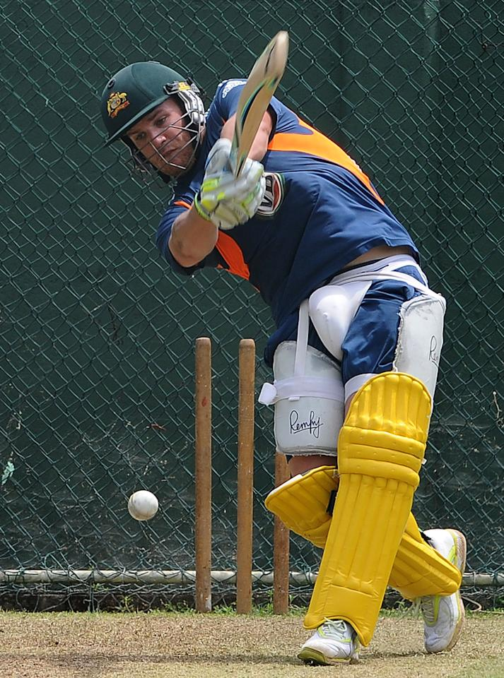 Australian cricketer Aaron Finch plays a shot during a practice session at the Sinhalease Sports Club (SSC) Ground in Colombo on August 1, 2011. Australia on July 26 included four uncapped players in its squad for the three-Test tour of Sri Lanka next month, while batsman Phil Hughes was anointed as Shane Watson's opening partner. Australia is on tour in Sri Lanka from August 6 to September 20, which also includes two Twenty20 matches and five one-dayers. AFP PHOTO / Lakruwan WANNIARACHCHI (Photo credit should read LAKRUWAN WANNIARACHCHI/AFP/Getty Images)