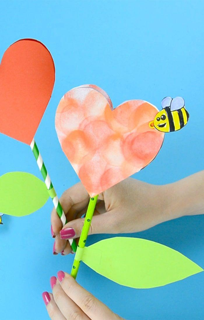 """<p>You could use a pencil instead of the straws to make this craft useful as well as cute!</p><p><strong>Get the tutorial at <a href=""""https://www.easypeasyandfun.com/paper-heart-flower-craft/"""" rel=""""nofollow noopener"""" target=""""_blank"""" data-ylk=""""slk:Easy Peasy and Fun"""" class=""""link rapid-noclick-resp"""">Easy Peasy and Fun</a>.</strong></p><p><strong><a class=""""link rapid-noclick-resp"""" href=""""https://www.amazon.com/Elmers-Liquid-School-Glue-Washable/dp/B072J37ZZD/?tag=syn-yahoo-20&ascsubtag=%5Bartid%7C10050.g.1584%5Bsrc%7Cyahoo-us"""" rel=""""nofollow noopener"""" target=""""_blank"""" data-ylk=""""slk:SHOP GLUE"""">SHOP GLUE</a><br></strong></p>"""