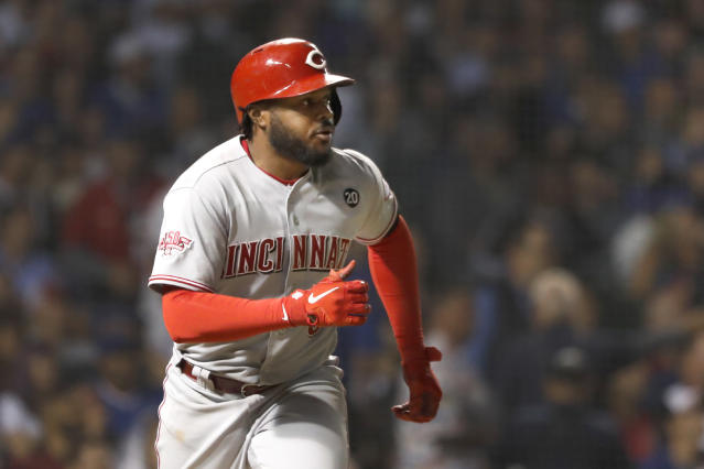 Cincinnati Reds' Phillip Ervin watches his sacrifice fly off Chicago Cubs relief pitcher Steve Cishek during the fourth inning of a baseball game Monday, Sept. 16, 2019, in Chicago. Jose Peraza scored on the play. (AP Photo/Charles Rex Arbogast)