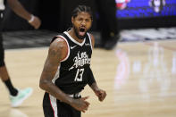Los Angeles Clippers guard Paul George celebrates after scoring during the first half in Game 3 of the NBA basketball Western Conference Finals against the Phoenix Suns Thursday, June 24, 2021, in Los Angeles. (AP Photo/Mark J. Terrill)