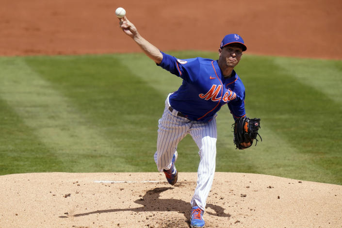 New York Mets starting pitcher Jacob deGrom throws during the first inning of a spring training baseball game against the Houston Astros, Tuesday, March 16, 2021, in Port St. Lucie, Fla. (AP Photo/Lynne Sladky)
