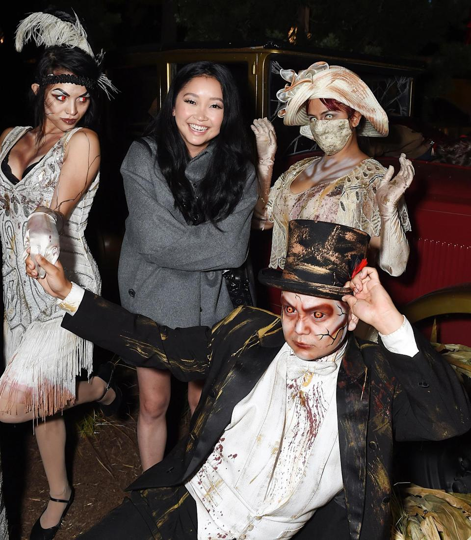 <p>smiling through the scary at Knott's Scary Farm in Buena Park, California, on Sept. 18.</p>
