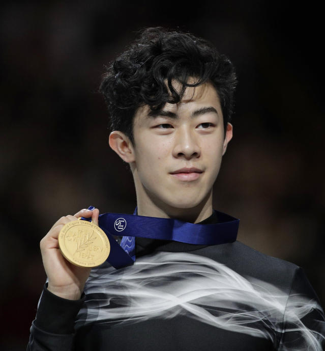 Nathan Chen from the U.S. stands on the podium with the gold medal for the men's free skating routine during the ISU World Figure Skating Championships at Saitama Super Arena in Saitama, north of Tokyo, Saturday, March 23, 2019. (AP Photo/Andy Wong)
