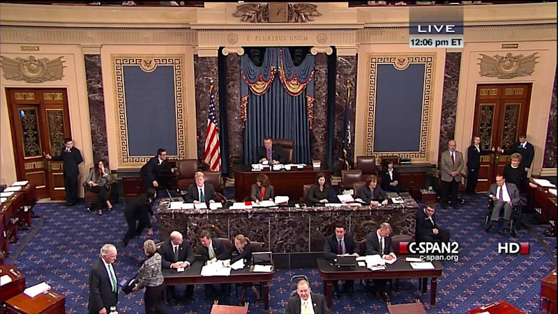 This handout video image provided by CSPAN2 shows former Senate Majority Leader Bob Dole, right, wheeled into the Senate Chamber on Capitol Hill in Washington, Tuesday, Dec. 4,2012, by his wife Elizabeth Dole. Frail and in a wheelchair, Dole was a startling presence on the Senate floor as lawmakers voted on a treaty on disabilities. The 89-year-old Republican was in the well of the Senate on the GOP side of the chamber, his wife Elizabeth nearby. Dole recently had been hospitalized but came to the Senate to push for the treaty.  (AP Photo/CSPAN2)