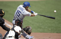 Los Angeles Dodgers' Austin Barnes connects for a two-run double in the fourth inning of the first baseball game in a doubleheader against the San Francisco Giants, Thursday, Aug. 27, 2020, in San Francisco. (AP Photo/Ben Margot)