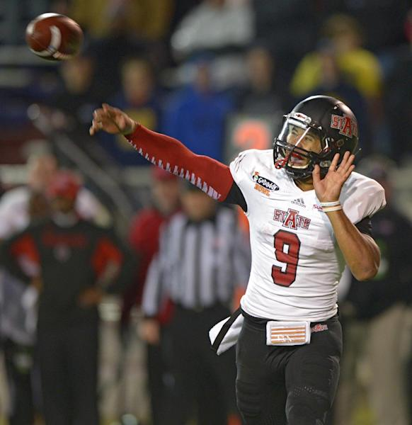 Arkansas State quarterback Fredi Knighten (9) passes against Ball State in the fourth quarter of the GoDaddy Bowl NCAA college football game in Mobile, Ala., Sunday, Jan. 5, 2014. Arkansas State defeated Ball State, 23-20. (AP Photo/G.M. Andrews)