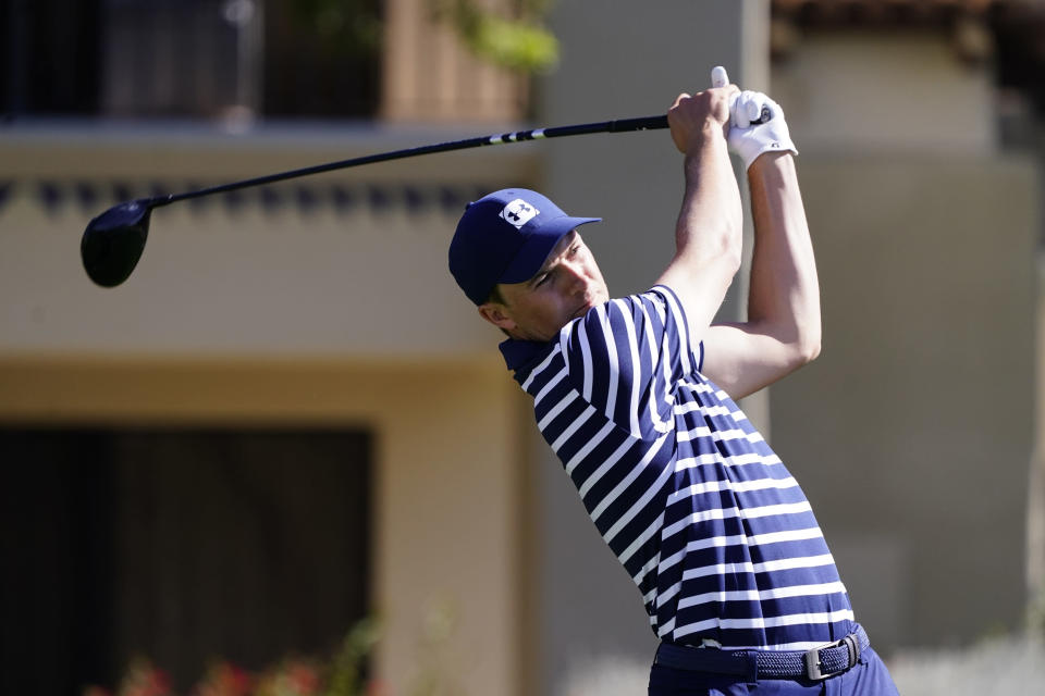 Jordan Spieth tees off on the fifth hole during the final round of a PGA golf tournament on Sunday, Feb. 7, 2021, in Scottsdale, Ariz. (AP Photo/Rick Scuteri)