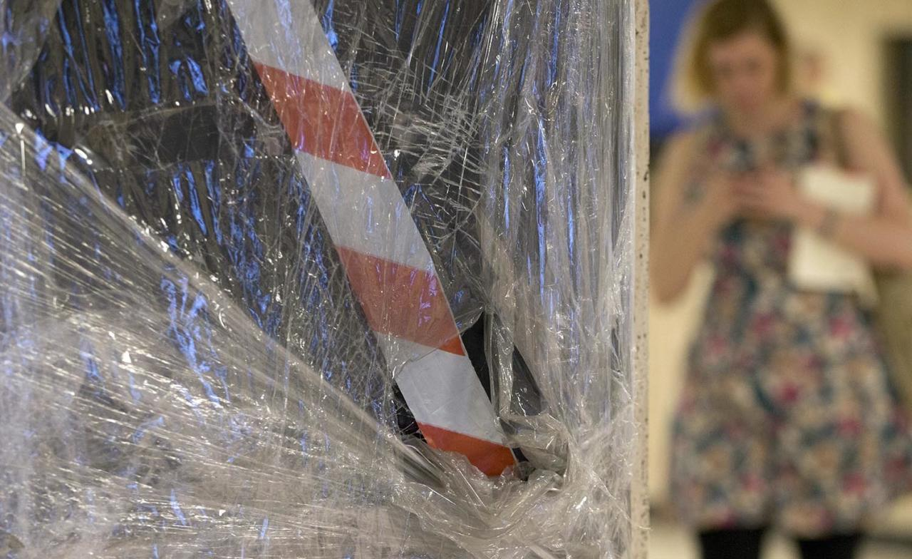 """<p>A woman checks her cellphone as she stands by a damaged signboard inside Central Station in Brussels on Wednesday, June 21, 2017. Belgian authorities said they foiled a """"terror attack"""" when soldiers shot a suspect in the heart of Brussels after a small explosion at a busy train station Tuesday on a night that continued a week of attacks in the capitals of Europe. (Virginia Mayo/AP) </p>"""