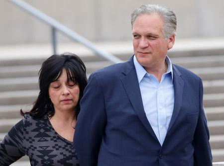 FILE PHOTO: Edward Mangano, Nassau County Executive, and his wife Linda, both facing federal corruption charges, leave arraignment hearings outside federal court in Central Islip, New York