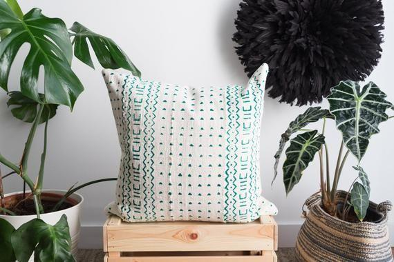 """<p><strong>Aishea HOME</strong></p><p>etsy.com</p><p><strong>$59.16</strong></p><p><a href=""""https://go.redirectingat.com?id=74968X1596630&url=https%3A%2F%2Fwww.etsy.com%2Flisting%2F818994290%2Fwhite-bogolan-cloth-cushion-green-pillow&sref=https%3A%2F%2Fwww.goodhousekeeping.com%2Fhome%2Fdecorating-ideas%2Fg35166809%2Fbest-home-products-january-2021%2F"""" rel=""""nofollow noopener"""" target=""""_blank"""" data-ylk=""""slk:Shop Now"""" class=""""link rapid-noclick-resp"""">Shop Now</a></p><p>One of the easiest ways to boost a living room's style factor is with a patterned pillow. The use of teal on this mud cloth design is guaranteed to add personality to any sofa.</p>"""
