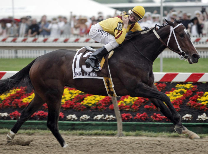 FILE - Jockey Calvin Borel gestures as he rides Rachel Alexandra to victory in the 134th running of the Preakness Stakes horse race at Pimlico Race Course in Baltimore, in this Saturday, May 16, 2009, file photo. The Preakness is the first horse race to release one of a kind digital souvenirs to auction off, NFTs like the ones Super Bowl champion Rob Gronkowski and the NBA's Golden State Warriors did. Officials see it as a chance for horse racing to reach a younger audience. (AP Photo/Peter Morgan, File)