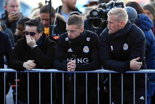 <p>Aiyawatt Srivaddhanaprabha, Jamie Vardy and goalkeeper Kasper Schmeichel pay tribute to club chairman Vichai Srivaddhanaprabha. Mike Egerton/PA Wire </p>