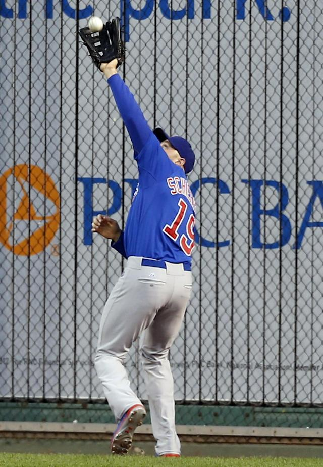 Chicago Cubs right fielder Nate Schierholtz makes a catch on a fly ball hit by Pittsburgh Pirates' Neil Walker in the first inning of the baseball game on Friday, Sept. 13, 2013, in Pittsburgh. (AP Photo/Keith Srakocic)