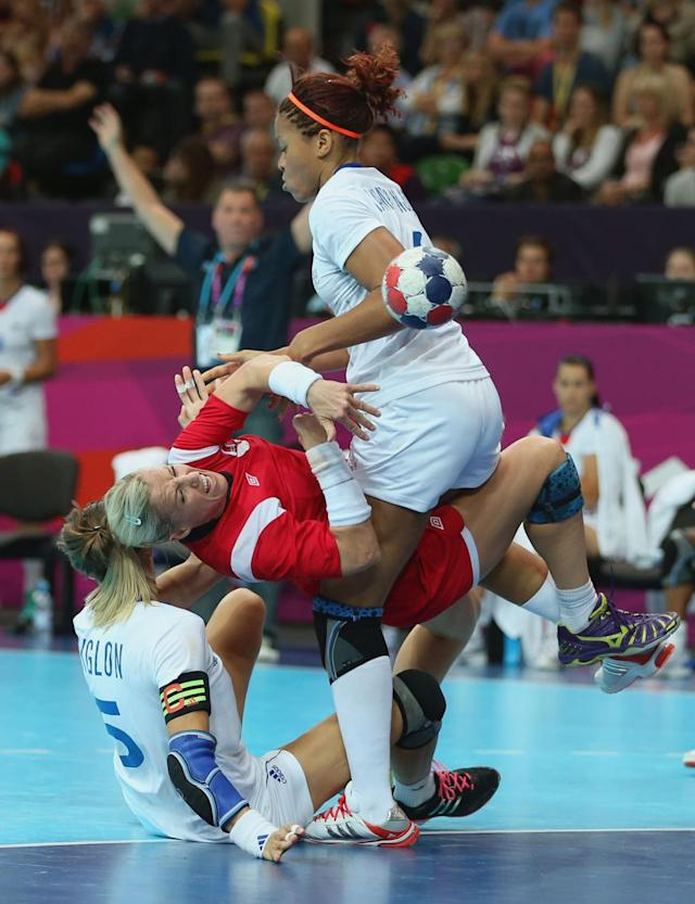 Heidi Loke of Norway clashes with Camille Ayglon and Alexandra Lacrabere of France in the Women's Handball preliminaries Group B - Match 6 between Norway and France on Day 1 of the London 2012 Olympic Games at the Copper Box on July 28, 2012 in London, England. (Photo by Jeff Gross/Getty Images)