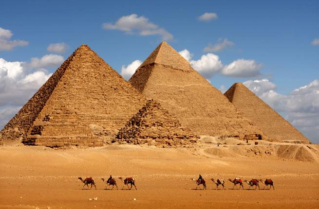 <p><strong>Where: </strong>Egypt</p>  <p>In the desert south of Cairo, testify to the legacy of the pharaohs of Ancient Egypt. The Pyramid of Khufu, commonly known as the Great Pyramid of Giza, is the largest of the three and the oldest of the Seven Wonders of the Ancient World (as well as the only one still in existence). Khafre and Menkaure (Khufu's grandson) built the two smaller pyramids. The Great Sphinx stands guard at the entrance of the complex, which includes smaller pyramids belonging to female members of the dynasty and tombs for their relatives and courtiers.</p>  <p><strong>Insider Tip:</strong> Access to the interior of the pyramids is on a rotating basis. Inquire at the ticket office; from there, you can take a tram to the site and explore on foot.</p>  <p><strong>Plan Your Trip:</strong> Visit </p>