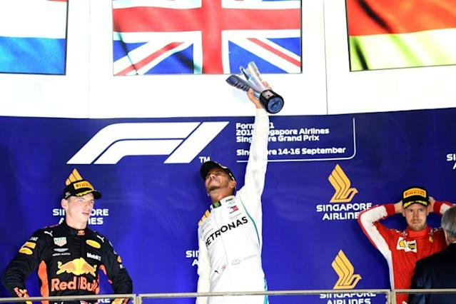 Lewis Hamilton celebrates his Singapore Grand Prix victory on the podium a year ago with second-placed Max Verstappen (left) and third-placed Sebastian Vettel (AFP Photo/Manan VATSYAYANA)
