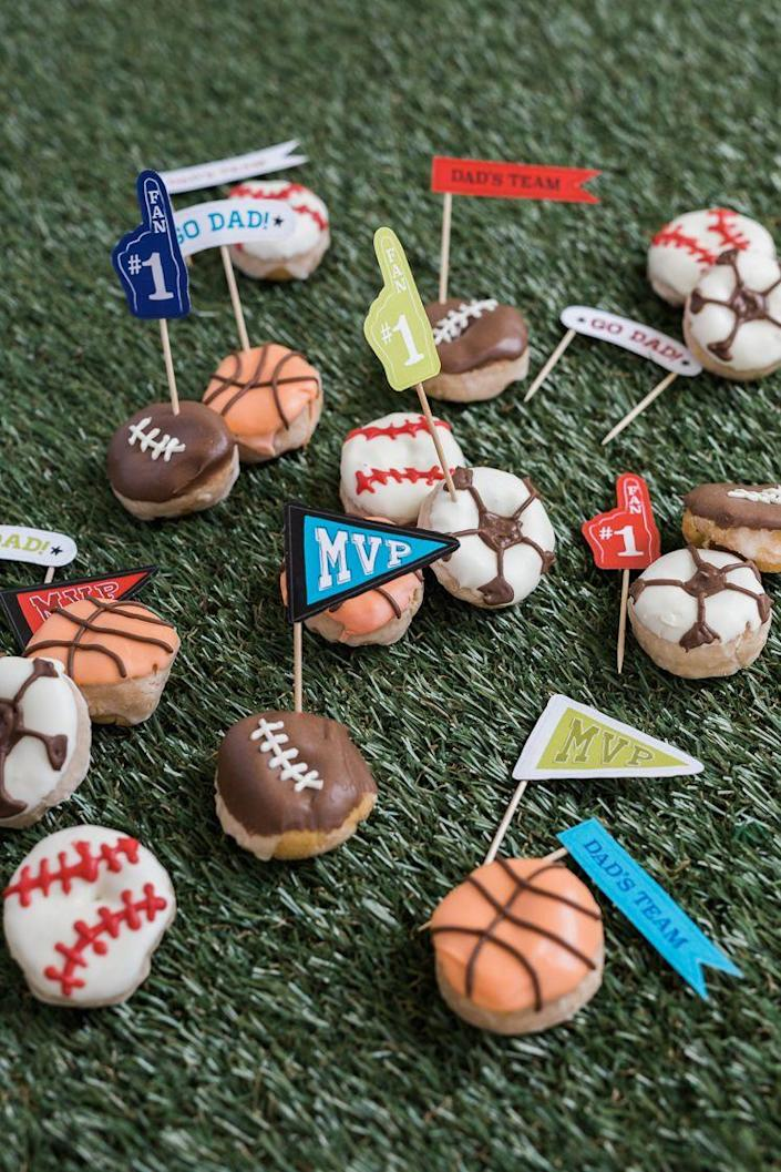 """<p>For delicious treats and a theme that Dad is sure to love, make these cute, sporty donuts. It'll put your decorating skills to the test as you make them together. </p><p><strong>Get the tutorial at <a href=""""http://thehousethatlarsbuilt.com/2017/05/fathers-day-sport-donuts.html/"""" rel=""""nofollow noopener"""" target=""""_blank"""" data-ylk=""""slk:The House That Lars Built"""" class=""""link rapid-noclick-resp"""">The House That Lars Built</a>.</strong></p><p><a class=""""link rapid-noclick-resp"""" href=""""https://go.redirectingat.com?id=74968X1596630&url=https%3A%2F%2Fwww.walmart.com%2Fip%2FToothpicks-500-Count%2F199965922&sref=https%3A%2F%2Fwww.thepioneerwoman.com%2Fholidays-celebrations%2Fg36333267%2Ffathers-day-activities%2F"""" rel=""""nofollow noopener"""" target=""""_blank"""" data-ylk=""""slk:SHOP TOOTHPICKS"""">SHOP TOOTHPICKS</a></p>"""