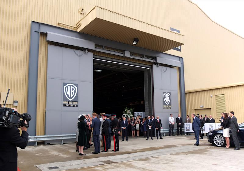 WATFORD, UNITED KINGDOM - APRIL 26: Prince William, Duke of Cambridge, Catherine, Duchess of Cambridge and Prince Harry attend the inauguration of Warner Bros. Studio Tour London on April 26, 2013 in Watford, England. (Photo by Karwai Tang/WireImage)