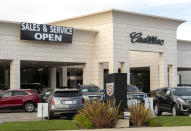 THOUSAND OAKS, CA - MAY 06: A Cadillac Dealership displays a sign stating its reopened during the Coronavirus Pandemic on May 06, 2020 in Thousand Oaks, California. The coronavirus pandemic worldwide has claimed over 263,000 lives and infected over 3.7 million people. (Photo by Josh Lefkowitz/Getty Images)