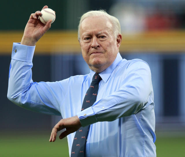 FILE - In this April 13, 2012, file photo, Atlanta Braves chairman emeritus: Bill Bartholomay throw out the ceremonial first pitch before a baseball game against the Milwaukee Brewers in Atlanta. Bartholomay, the former Braves owner who moved the team from Milwaukee to Atlanta in 1966, died Wednesday, March 25, 2020, at New York-Presbyterian Hospital, according to his daughter, Jamie. He was 91. Bartholomay sold the Braves to Ted Turner in 1976 but remained as chairman of the team's board of directors until 2003, when he assumed an emeritus role. (AP Photo/John Bazemore, File)
