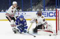 Chicago Blackhawks goaltender Malcolm Subban (30) makes a pad save on a shot by Tampa Bay Lightning center Yanni Gourde (37) during the second period of an NHL hockey game Wednesday, Jan. 13, 2021, in Tampa, Fla. Defending for Chicago is defenseman Connor Murphy (5). (AP Photo/Chris O'Meara)