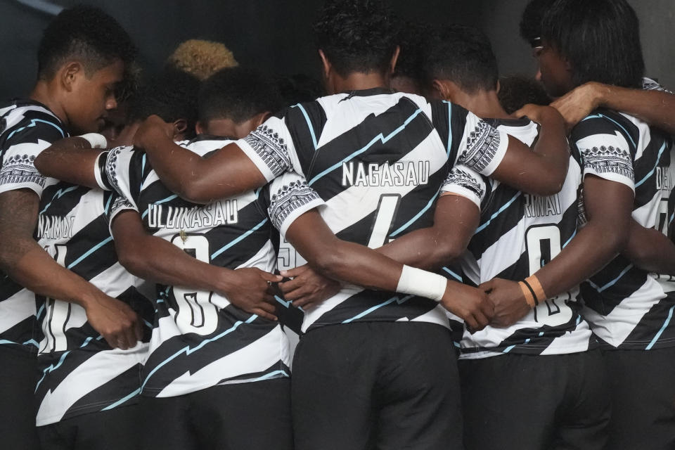 Fiji players huddle up as they prepare to enter the stadium for their women's rugby sevens quarterfinal match against Australia at the 2020 Summer Olympics, Friday, July 30, 2021 in Tokyo, Japan. (AP Photo/Shuji Kajiyama)