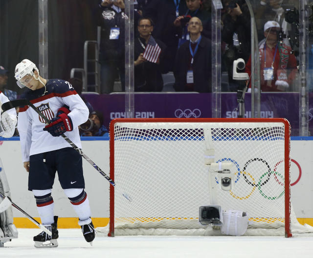 USA defenseman Kevin Shattenkirk reacts after losing to Canada 1-0 in a men's semifinal ice hockey game at the 2014 Winter Olympics, Friday, Feb. 21, 2014, in Sochi, Russia. (AP Photo/Julio Cortez)