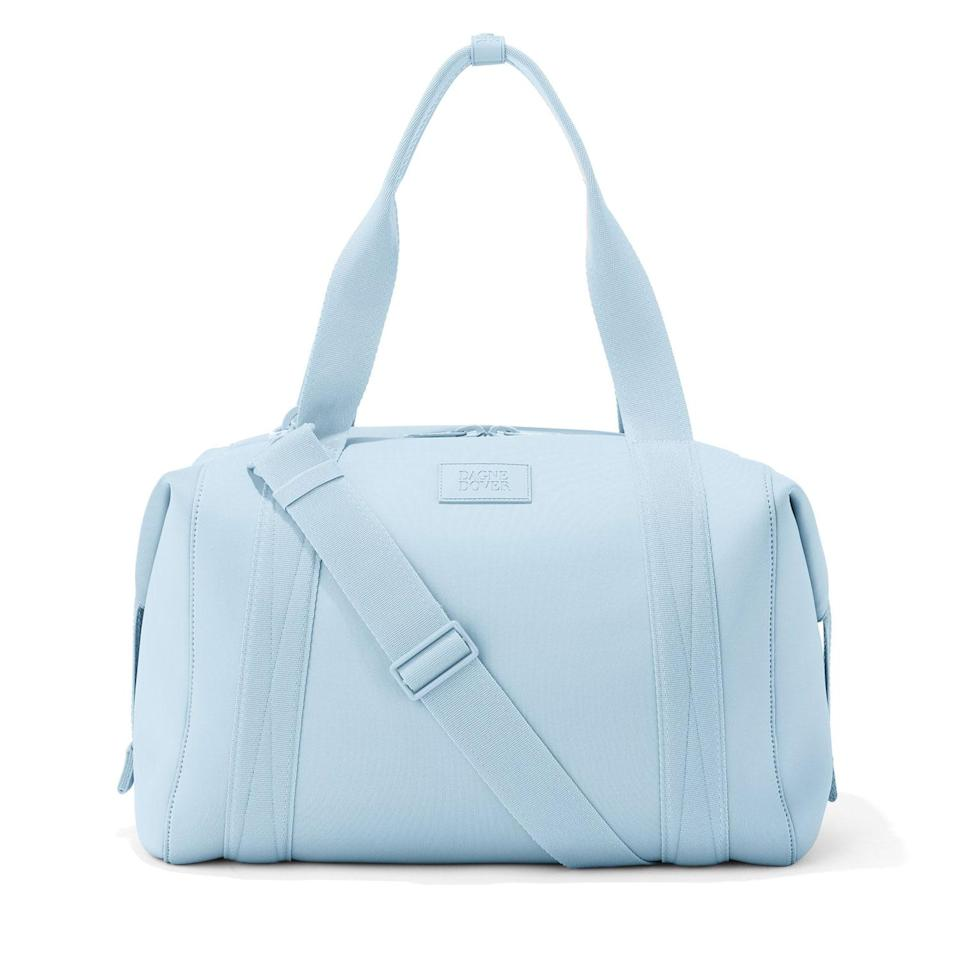 <p>This brand is a cult favorite of avid travelers, gym-goers, and working professionals, and certainly lives up to the hype. This chic one-tonal duffle bag is compact and not bulky in the slightest, but the nylon material makes it sturdy enough to carry a million things. Not to mention it's easily organizable with tons of compartments for you to keep all your small belongings. It's pretty perfect for a long weekend trip, and will look cute with your travel outfit, too. Say good bye to checking bags.</p>