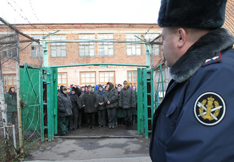 """In this photo taken Nov. 30, 2011, imprisoned women wait to be escorted for work at a women's prison outside the city of Orel, central Russia. Two members of the punk band Pussy Riot will serve their sentence in a penal colony far from Moscow that is like what a former inmate describes as a """"nasty Girl Scout camp."""" Although Russia's prison system is a far cry from Stalin's gulag, the principle remains the same: to isolate people from their families and wear them down through """"corrective labor,"""" which for women usually means hunching over a sewing machine. Maria Alyokhina and Nadezhda Tolokonnikova will have to quickly learn the inner laws of prison life, survive the dire food and medical care, and risk reprisal from inmates either offended by their """"punk prayer"""" against President Vladimir Putin or ordered to pressure them by higher authorities. (AP Photo/Yuri Tutov)"""