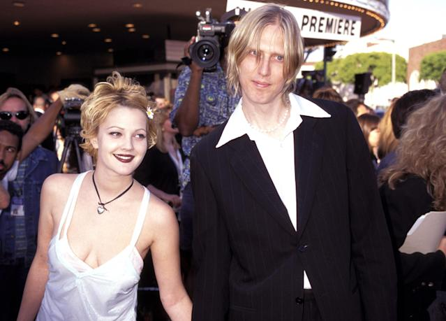 Eric Erlandson of Hole accompanied Barrymore at the 1995 debut of her movie <em>Batman Forever</em>. (Photo: KMazur/WireImage)