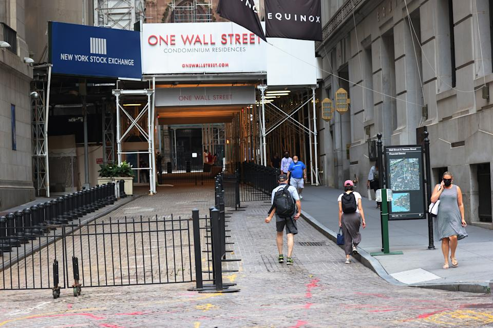 NEW YORK, NEW YORK - JULY 23: People walk along Wall Street near the New York Stock Exchange (NYSE) on July 23, 2020 in New York City. On Wednesday July 22, the market had its best day in 6 weeks. (Photo by Michael M. Santiago/Getty Images)