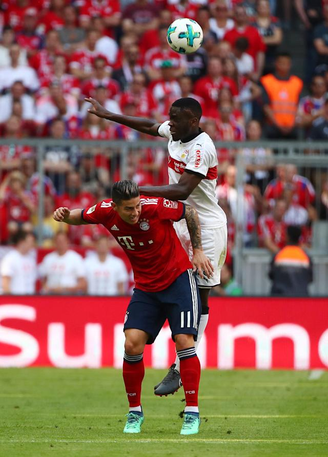 Soccer Football - Bundesliga - Bayern Munich v VfB Stuttgart - Allianz Arena, Munich, Germany - May 12, 2018 Stuttgart's Orel Mangala in action with Bayern Munich's James Rodriguez REUTERS/Michael Dalder DFL RULES TO LIMIT THE ONLINE USAGE DURING MATCH TIME TO 15 PICTURES PER GAME. IMAGE SEQUENCES TO SIMULATE VIDEO IS NOT ALLOWED AT ANY TIME. FOR FURTHER QUERIES PLEASE CONTACT DFL DIRECTLY AT + 49 69 650050