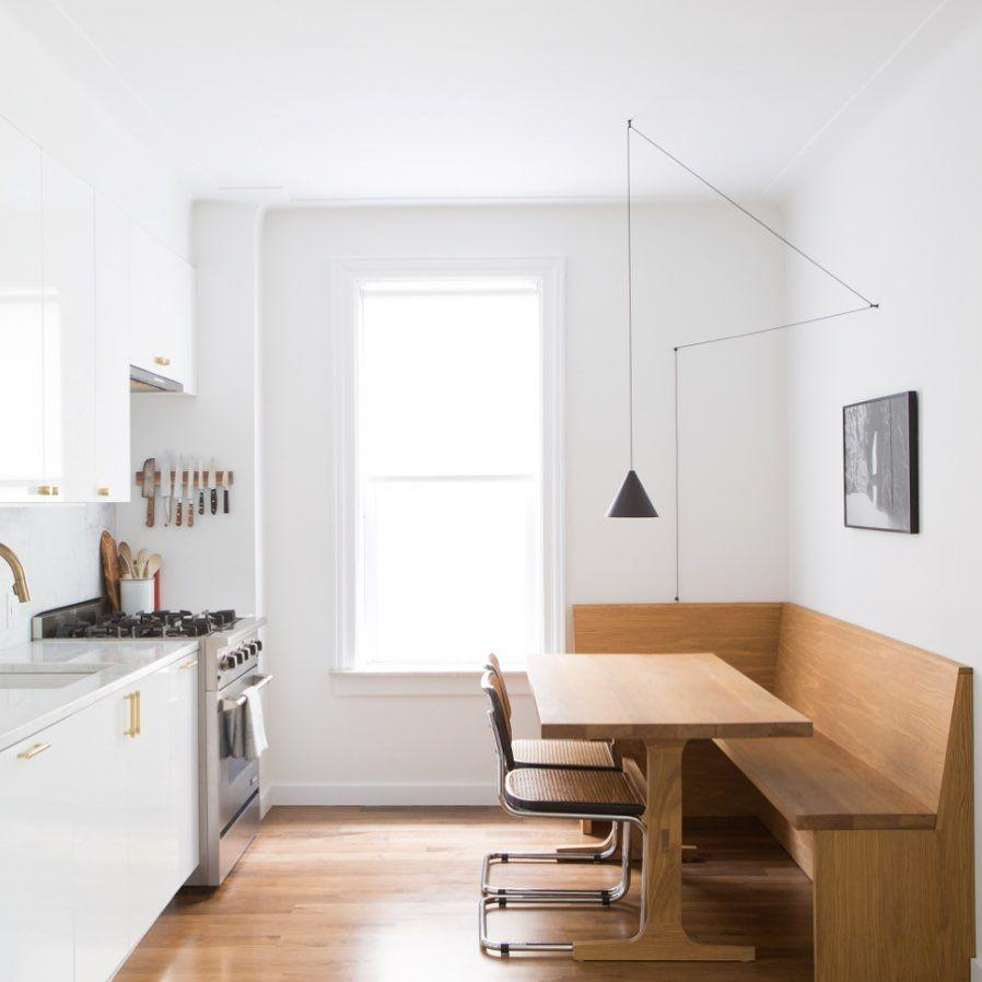 """<p>If your kitchen and dining area are one in the same, consider this wooden accent idea. With a crisp white kitchen and natural wood booth, it's a minimalist-chic design that's neutral and fresh.</p><p><strong>See more at <a href=""""https://www.instagram.com/space_exploration_design/"""" target=""""_blank"""">Space Exploration Design</a>.</strong></p><p><strong><a class=""""body-btn-link"""" href=""""https://www.amazon.com/WISBEAM-Pendant-Lighting-Fixture-Included/dp/B07QPHLH18/?tag=syn-yahoo-20&ascsubtag=%5Bartid%7C10050.g.31265776%5Bsrc%7Cyahoo-us"""" target=""""_blank"""">SHOP PENDANT LIGHTING</a><br></strong></p>"""