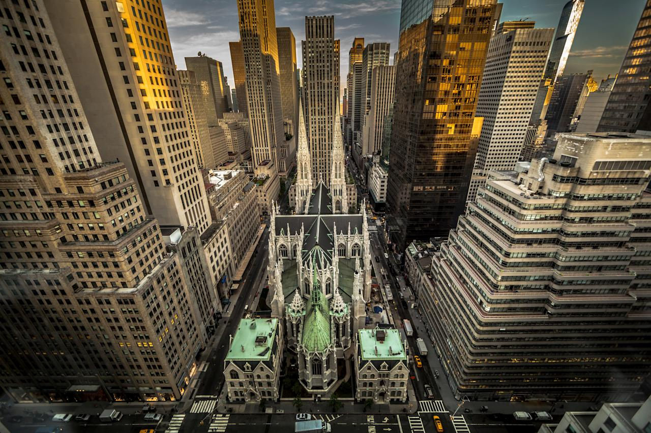 <p>Italian-born Kitty Cohen won the travel category with her aerial image of New York, snapped from the 32nd storey of a hotel at 5am on an August morning. The banker who lives in France said: 'I was trying to catch NY waking up at sunrise with yellow cabs and delivery tracks around St Patrick Cathedral.' (SWNS) </p>